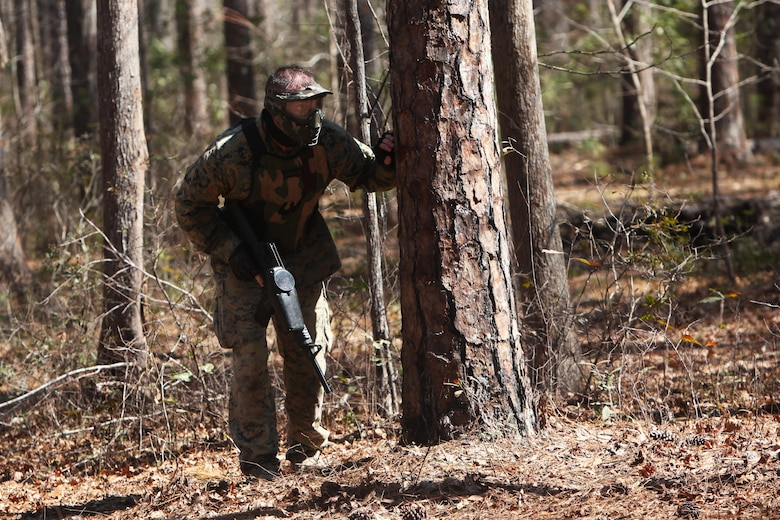 Capt. Timothy G. Otto participates in a team paintball match during the Devil Dog Dare Challenge Course at Marine Corps Air Station Cherry Point, N.C., March 10, 2016. The Devil Dog Dare Challenge Course was designed for Marines and Sailors to get engaged in Operation Adrenaline Rush. OAR is a training tool designed to introduce Marines to activities that serve as alternatives to uncharacteristic behaviors often associated with incidents involving recently deployed Marines. Otto is an electronic maintenance officer with G-6, 2nd Marine Aircraft Wing. (U.S. Marine Corps photo by Pfc. Nicholas P. Baird/Released)