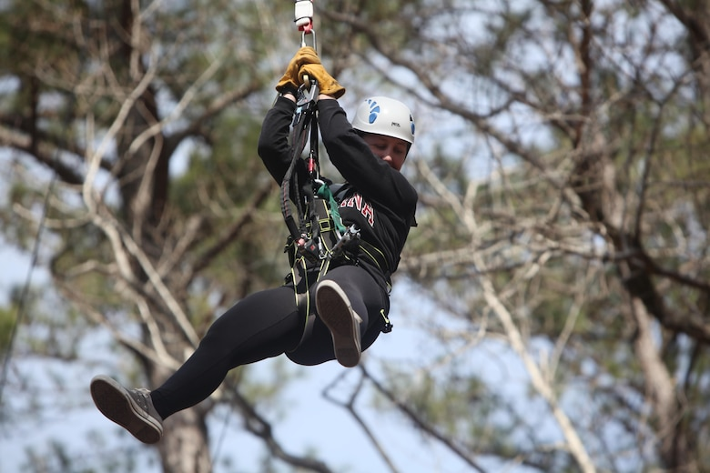 Sgt. Laura B. Freitas descends from a 65-foot free fall tower during the Devil Dog Dare Challenge Course at Marine Corps Air Station Cherry Point, N.C., March 10, 2016. The Devil Dog Dare Challenge Course was designed for Marines and Sailors to get engaged in Operation Adrenaline Rush. OAR is a training tool designed to introduce Marines to activities that serve as alternatives to uncharacteristic behaviors often associated with incidents involving recently deployed Marines. Freitas is a cyber network operator, G-6, 2nd Marine Aircraft Wing. (U.S. Marine Corps photo by Pfc. Nicholas P. Baird/Released)
