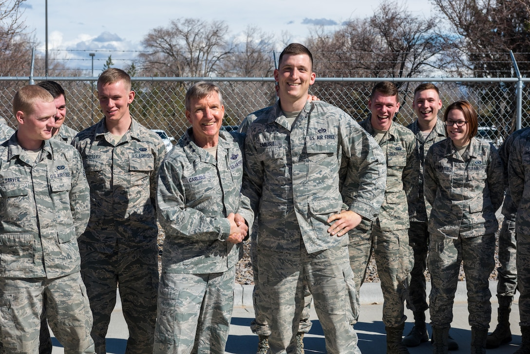 U.S. Air Force Gen. Hawk Carlisle, commander of Air Combat Command, shakes hands with Staff Sgt. Jared Carlisle, 726th Air Control Squadron, quality assurance evaluator at Mountain Home Air Force Base, Idaho, March 7, 2016. Gen. Carlisle joked with Staff Sgt. Carlisle when he realized they shared the same name. (U.S. Air Force photo by Airman 1st Class Connor J. Marth/Released)