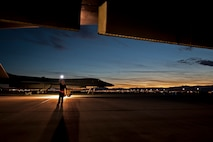Senior Airman Jeremy Holloway, a dedicated crew chief assigned to the 28th Aircraft Maintenance Squadron, Ellsworth Air Force Base, S.D., performs aircraft structure checks on a B-1 Lancer prior to a Red Flag 16-2 night training sortie March, 10, 2016 at Nellis Air Force Base, Nev. The importance of attention to detail is intensified during night operations. (U.S. Air Force photo by Senior Airman Joshua Kleinholz)
