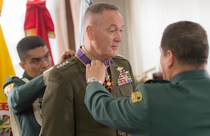 Gen. Juan Pablo Rodriguez, commander of Colombia's armed forces,  right, presents the Fe en la Causa medal to Marine Corps Gen. Joseph F. Dunford Jr., chairman of the Joint Chiefs of Staff, for his support of Colombian military efforts in Bogota, Colombia, March 10, 2016. DoD photo by Navy Petty Officer 2nd Class Dominique A. Pineiro