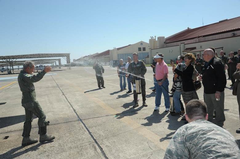 Former Capt. Paul Granger, a B-52 Stratofortress pilot during the Vietnam War, is welcomed back after his Freedom Flight at Joint Base San Antonio-Randolph, Texas, March 3, 2016. Granger was shot down while on a combat mission near Hanoi in North Vietnam on Dec. 20, 1972, in support of Operation Linebacker II. (U.S. Air Force photo/Joel Martinez)