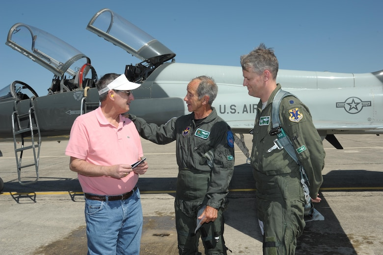 Lt. Col. Joel Deboer, right, the 560th Flying Training Squadron commander, and former Capt. Paul Granger, middle, present Freedom Flight patches to Thomas Klomann at Joint Base San Antonio-Randolph, Texas, March 3, 2016. Granger and Klomann were shot down in the same B-52 Stratofortress while on a combat mission near Hanoi in North Vietnam on Dec. 20, 1972, in support of Operation Linebacker II. (U.S. Air Force photo/Joel Martinez)
