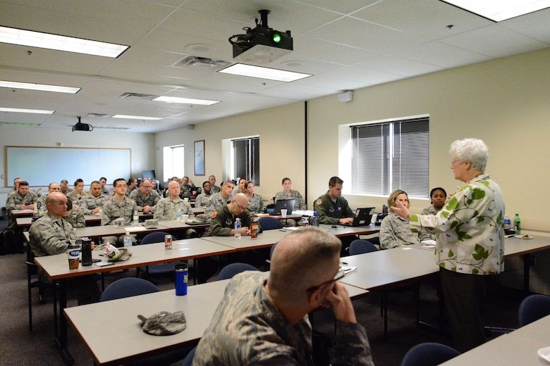 Maggie Bonner, a protocol special event management and intrnational relations specialist for the U.S. Air Force Services Agency, teaches airmen from the 139th Airlift Wing about protocol at Rosecrans Air National Guard Base in St. Joseph, Mo. on March 10, 2016. Bonner has been teaching protocol for 59 years. (U.S. Air National Guard photo by Senior Airman Bruce Jenkins/Released)