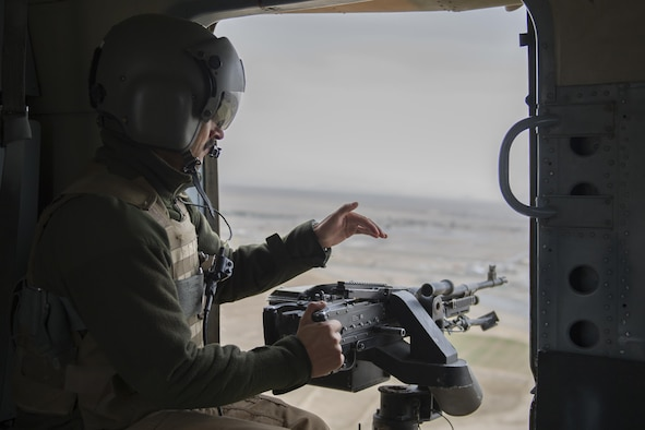 An Afghan Air Force Mi-17 aerial gunner from the Kandahar Air Wing scans the area during a takeoff, landing and emergency-maneuver training mission near Kandahar Airfield, Afghanistan, March 3, 2016. Members of the Afghan Air Force at Kandahar Airfield are advised by Train Advise Assist Command-Air, a U.S. functional command, which assists Afghan partners to develop a professional, capable and sustainable force. (U.S. Air Force photo/Tech. Sgt. Robert Cloys)
