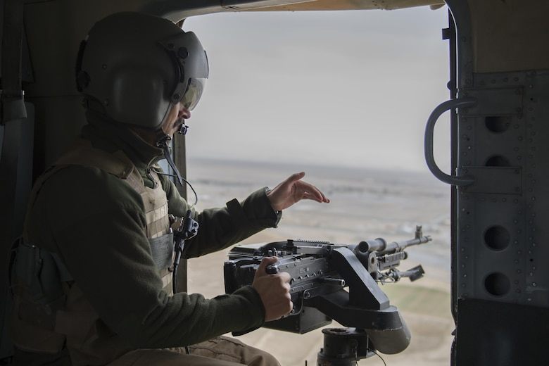 An Afghan Air Force Mi-17 aerial gunner from the Kandahar Air Wing scans the area during a take off, landing, and emergency-maneuver training mission near Kandahar Airfield, Afghanistan, March 3, 2016. Members of the Afghan Air Force at KAF are advised by Train Advise Assist Command - Air, a U.S. functional command that assists our Afghan partners to develop a professional, capable and sustainable force. (U.S. Air Force photo/Tech. Sgt. Robert Cloys)