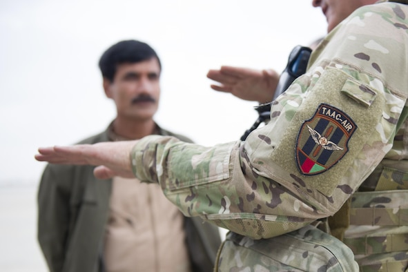 A Train Advise Assist Command - Air Mi-17 air advisor gives feedback to Afghan Air Force Mi-17 pilots after a training mission near Kandahar Airfield, Afghanistan, March 3, 2016. As a functional command, TAAC-Air assists our Afghan partners to develop a professional, capable and sustainable force. (U.S. Air Force photo/Tech. Sgt. Robert Cloys)