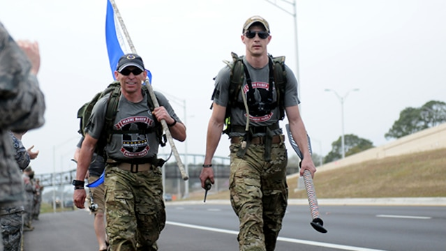 15 Marines and three civilians started a 770-mile ruck from Navarre, Florida, to Marine Corps Base Camp Lejeune, North Carolina to honor 11 service members who died in a helicopter crash one year ago. Two of the ruckers, including Marine Staff Sgt. Justin Bentley (right), continue the ruck past Hurlburt Field, Florida.