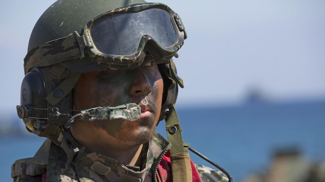 A Marine with the Republic of Korea Marine Corps listens to a brief for an amphibious assault rehearsal, on Doksukri Beach, Republic of Korea, March 11, 2016, for Exercise Ssang Yong 16. Ssang Yong is a biennial military exercise focused on strengthening the amphibious landing capabilities of the ROK, the U.S., New Zealand and Australia.
