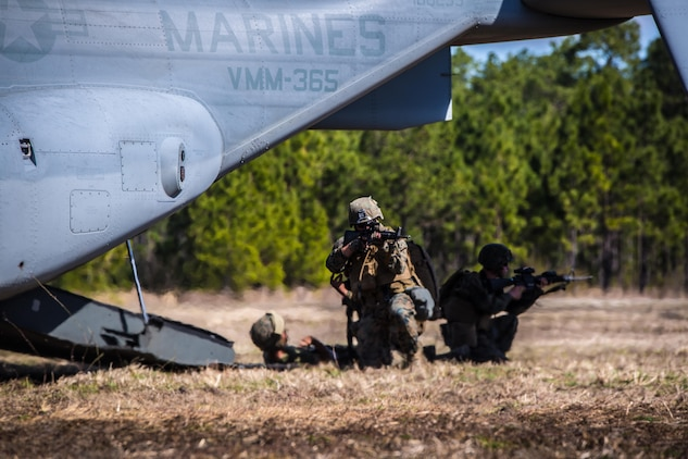 Marines with 2nd Combat Engineer Battalion, provide security before loading a casualty into a MV-22 Osprey during a casualty evacuation exercise at Landing Zone Penguin at Camp Lejeune, N.C., March 10, 2016. The training allowed Marines with Marine Medium Tiltrotor Squadron 365 and 2nd CEB to work together in order to be well prepared to conduct a successful CASEVAC in any situation they may encounter while deployed, to ultimately save lives.  (U.S. Marine Corps photo by Lance Cpl. Erick Galera/Released)