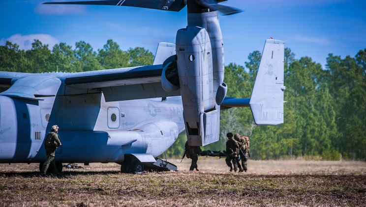 Marines with 2nd Combat Engineer Battalion, load a casualty onto an MV-22B Osprey during a casualty evacuation exercise at Landing Zone Penguin at Camp Lejeune, N.C., March 10, 2016. The training allowed Marines with Marine Medium Tiltrotor Squadron 365 and 2nd CEB to train together in order to be well prepared to conduct a successful CASEVAC in any situation they may encounter while deployed, to ultimately save lives.  (U.S. Marine Corps photo by Lance Cpl. Erick Galera/Released)