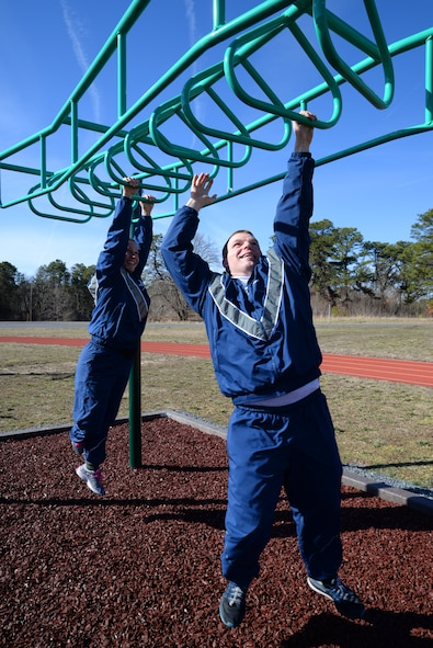 U.S. Air Force Tech. Sgts. Rosemarie Perry, left, and Bob Johnson, with the 177th Fighter Wing Logistics Readiness Squadron, New Jersey Air National Guard, try out new workout stations located alongside the on-base running track at the Atlantic City Air National Guard Base, N.J. on Mar. 3, 2016. New workout stations include: the back extension, horizontal bars, push up bars, a sit up bench, the sky climber (a variation of a horizontal ladder), and uneven bars, and can be used for high-intensity workouts including cardio and strength intervals. (U.S. Air National Guard photo by Master Sgt. Andrew J. Moseley/Released)