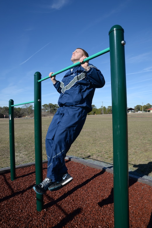 U.S. Air Force Tech. Sgt. Bob Johnson, management inspector with the 177th Fighter Wing Logistics Readiness Squadron of the New Jersey Air National Guard, does chin-ups at a new workout station located alongside the on-base running track at the Atlantic City Air National Guard Base, N.J., March 3, 2016. New workout stations include: the back extension, horizontal bars, pushup bars, a situp bench, the sky climber (a variation of a horizontal ladder), and uneven bars, and can be used for high-intensity workouts including cardio and strength intervals. (U.S. Air National Guard photo by Master Sgt. Andrew J. Moseley/Released)