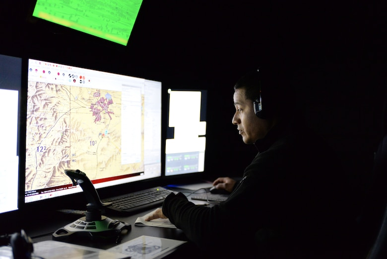 A picture of Harry Nieves, civilian contractor, sitting at the console of the 227th Air Support Operations Squadron's (ASOS) new $1.2 million Air National Guard Advanced JTAC Training System.