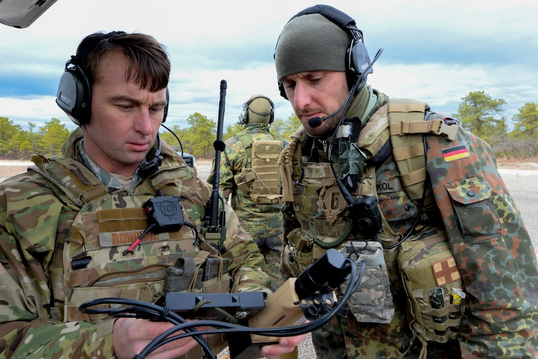 From left, U.S. Air Force Tech. Sgt. Chris Donohue, Joint Terminal Attack Controller (JTAC) with the 227th Air Support Operations Squadron (ASOS), and German armed forces JTAC 1st Lt. Marius Sokol prepare equipment for close air support training at the Warren Grove Bombing Range in Ocean County, N.J. on Feb. 25, 2016. German armed forces JTACs partnered with the 227th ASOS, from the New Jersey Air National Guard's 177th Fighter Wing, for a five day combined training exercise which included an F-16 familiarization brief and training in the 227th's new $1.2 million Air National Guard Advanced JTAC Training System.  (U.S. Air National Guard photo by Master Sgt. Andrew J. Moseley/Released)