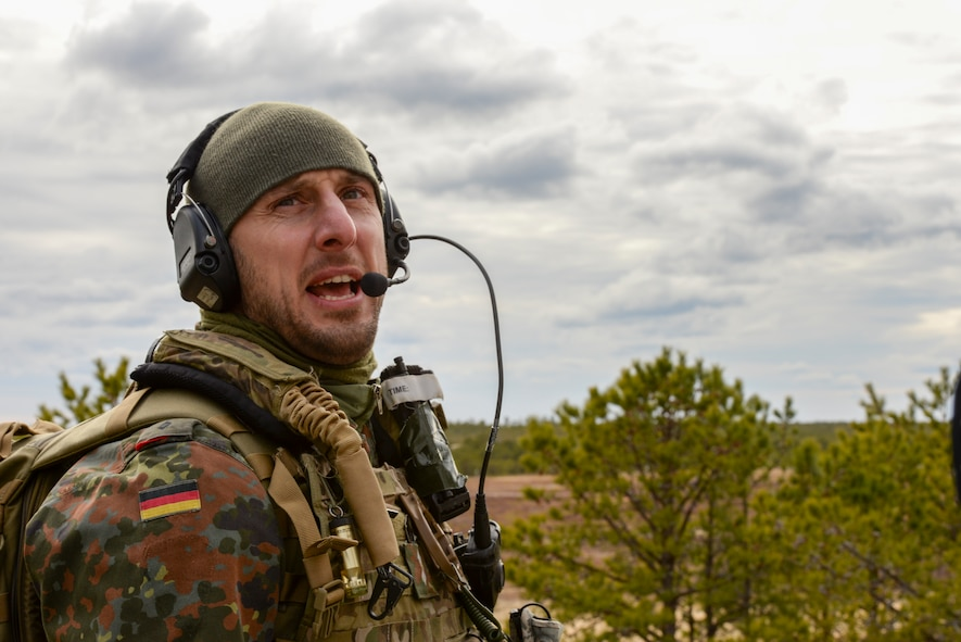 German armed forces 1st Lt. Marius Sokol, Joint Terminal Attack Controller (JTAC) from the 131st Artillery Battalion in Weiden, Germany, performs close air support training at the Warren Grove Bombing Range in Ocean County, N.J. on Feb. 25, 2016. German JTACs partnered with the 227th Air Support Operations Squadron, from the New Jersey Air National Guard's 177th Fighter Wing, for a five day combined training exercise which included an F-16 familiarization brief and training in the 227th's new $1.2 million Air National Guard Advanced JTAC Training System.  (U.S. Air National Guard photo by Master Sgt. Andrew J. Moseley/Released)