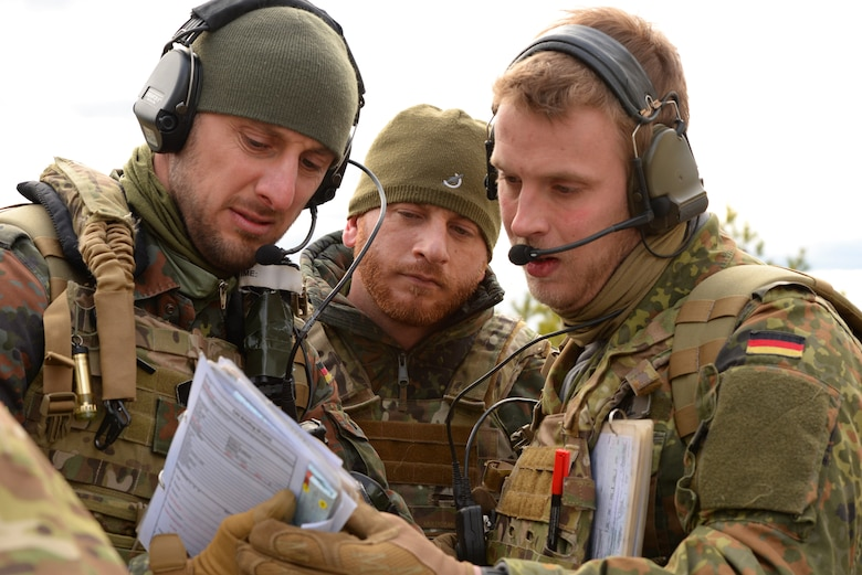 A picture of German armed forces Joint Terminal Attack Controllers (JTACs) 1st Lt. Marius Sokol, Capt. Sebastian Pflueger and 2d Lt. Michael Barthel, performing close air support training.