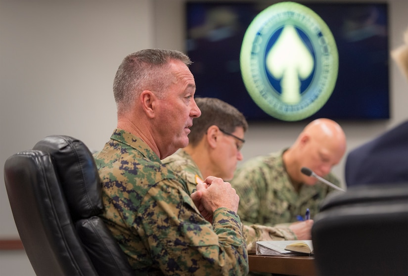 Marine Corps Gen. Joseph F. Dunford Jr., chairman of the Joint Chiefs of Staff, foreground, speaks with general and flag officers during a briefing alongside Gen. Joseph L. Votel, commander of U.S. Special Operations Command, on MacDill Air Force Base, Fla., March 11, 2016. DoD photo by Navy Petty Officer 2nd Class Dominique A. Pineiro