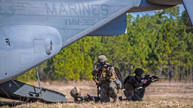 Marines with 2nd Combat Engineer Battalion, provide security before loading a casualty into a MV-22 Osprey during a casualty evacuation exercise at Landing Zone Penguin at Marine Corps Base Camp Lejeune, N.C., March 10, 2016. The training allowed Marines with Marine Medium Tiltrotor Squadron 365 and 2nd CEB to work together in order to be well prepared to conduct a successful CASEVAC in any situation they may encounter while deployed, to ultimately save lives.