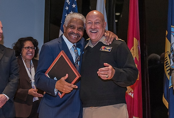 Charles Tennant, Sr joined Navy Rear Adm. John King for a commemorative gift presentation after his insightful history lesson.