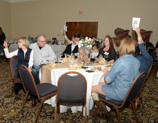 There were several friendly bidding wars during the Officers' Spouses' Club Denim and Diamonds Scholarship and Charity Fundraiser held at Merry Acres Inn & Event Center recently. The auction was held to raise funds for military dependents, spouses and non-profit organizations.