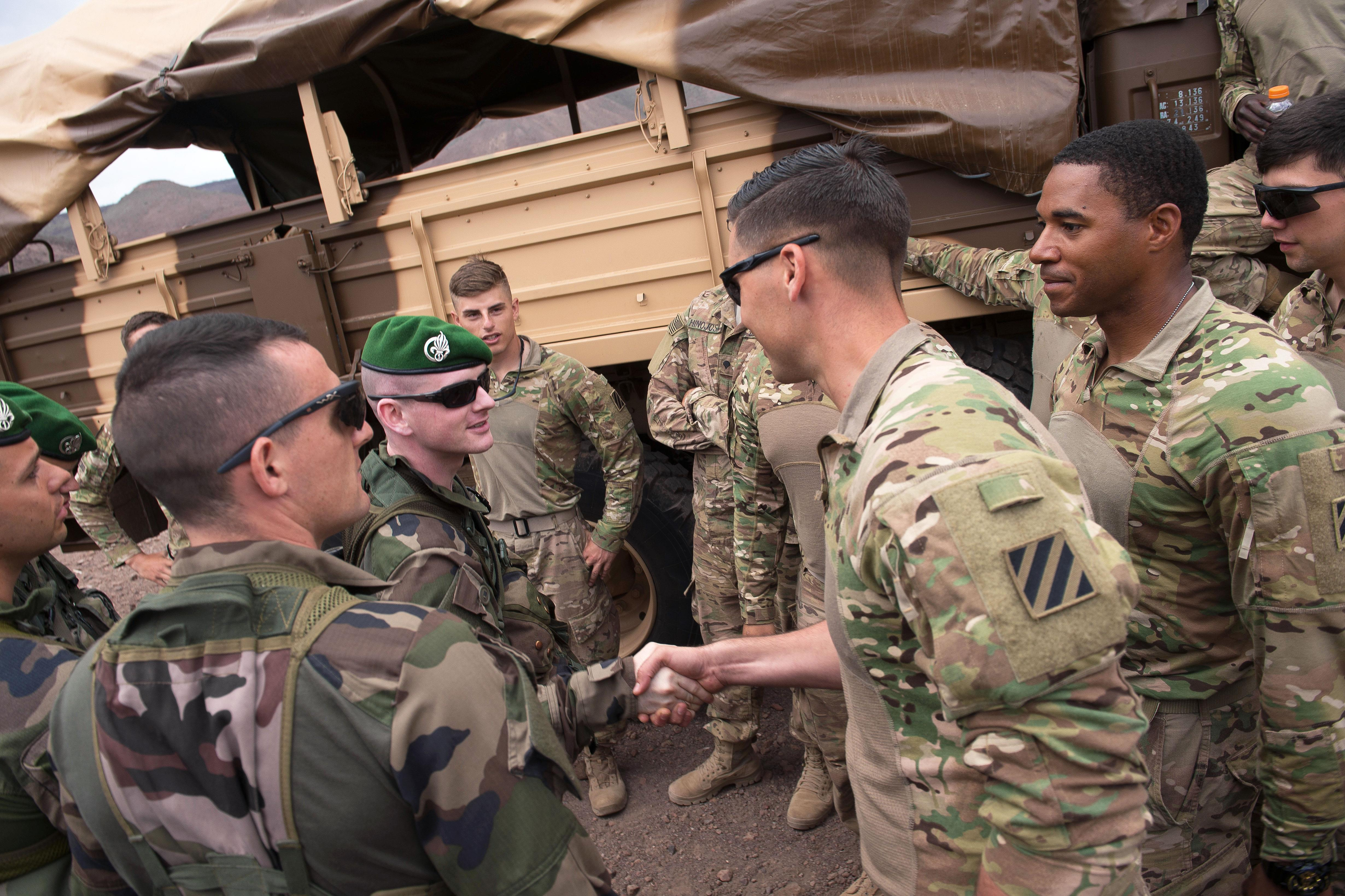 Us department of defense photos photo gallery us soldiers greet french foreign legion soldiers before participating in small arms training at a firing m4hsunfo