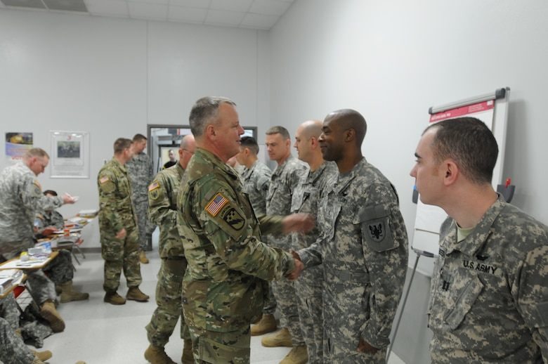 Brig. Gen. Scott Morcomb, Commanding General of the 11th Theater Aviation Command (TAC), greets his soldiers returning from an 11-month deployment to Kosovo in support of NATO's KFOR mission, Mar. 7, 2016. The 11th TAC has deployed units to Kosovo over the last several years in support of this mission of establishing a safe and secure environment for the people of Kosovo. (U.S. Army Photo by Capt. Matthew Roman, 11th Theater Aviation Command Public Affairs Officer)