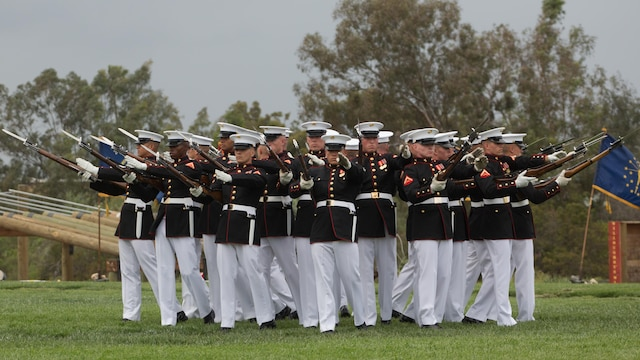 Marines with the Silent Drill Platoon perform at Marine Corps Air Station Miramar, California, March 11. Their performance was part of the Battle Color Ceremony aboard the air station.