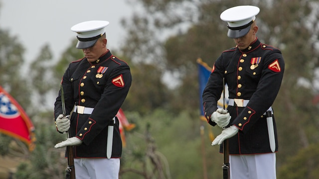 Marines with the Silent Drill Platoon affix bayonets to their rifles during a performance at Marine Corps Air Station Miramar, California, March 11. Their performance was part of the Battle Color Ceremony aboard the air station.