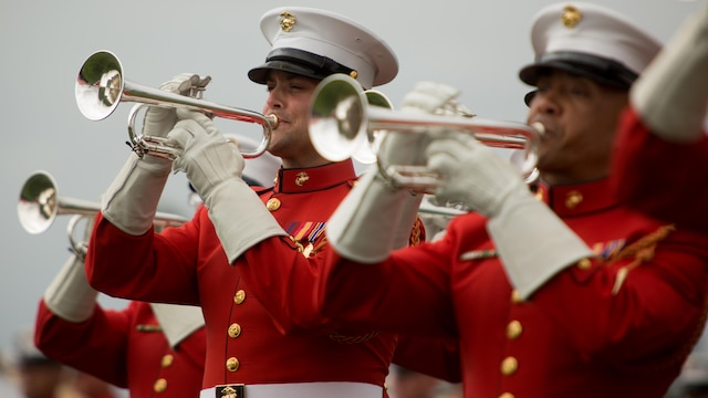 Marines with the United States Marine Drum and Bugle Corps perform at Marine Corps Air Station Miramar, California, March 11. These Marines wear red jackets which sets them apart from other bands in the Marine Corps.