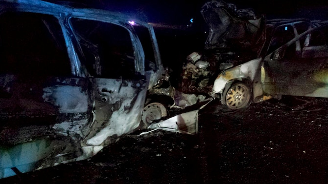 What is left of two cars after a potentially fatal accident sits on the side of the road May 12, 2014, near Royal Air Force Mildenhall, England. Staff Sgt. Vicente Gomez, a 100th Aircraft Maintenance Squadron crew chief, performed life-saving assistance to the victims of the crash. Gomez was presented with the Airman's Medal for his courageous acts. (Courtesy photo)