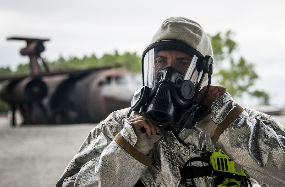 Staff Sgt. Matthew Harris, 919th Special Operations Civil Engineer Squadron, gears up prior to a live-fire training exercise March 4 at Hurlburt Field, Fla.  The Reserve Airmen teamed with their active-duty special operations firefighters to complete their annual live-fire training during the March unit training assembly.  (U.S. Air Force photo/Tech. Sgt. Sam King)