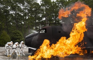 A team of 919th Special Operations Civil Engineer Squadron firefighters battle a huge blaze during a live-fire training exercise March 4 at Hurlburt Field, Fla.  The Reserve Airmen teamed with their active-duty special operations firefighters to complete their annual live-fire training during the March unit training assembly.  (U.S. Air Force photo/Tech. Sgt. Sam King)