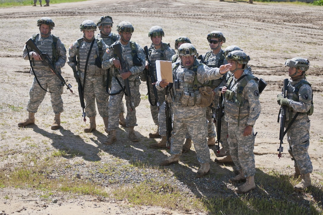 Staff Sgt. Ramon Brenescolon, a Soldier with the 475th Engineer Company (Horizontal), instructs his squad where the left and right limits of fire are during Combat Support Training Exercise 78-16-01 at Fort Hunter Liggett, Calif., March 8, 2016. CSTX 78-16-01 is a U.S. Army Reserve exercise conducted at multiple locations across the country designed to challenge combat support units and Soldiers to improve and sustain skills necessary during a deployment. (U.S. Army photo by Staff Sgt. Dalton Smith/Released)