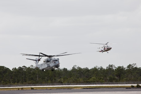 A CH-53K King Stallion aircraft, left, prepares to land at Sikorsky Aircraft Corporation, Jupiter, Fla., March 8, 2016. The CH-53K will replace the CH-53E Super Stallion aircraft, currently used by the Marine Corps. (U.S. Marine Corps photo by Staff Sgt. Gabriela Garcia/Released)