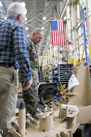 Commandant of the Marine Corps Gen. Robert B. Neller looks at equipment during a tour of Marine Depot Maintenance Command at Albany, Ga., March 9, 2016. Neller toured the repair facility to assess its operational capabilities and meet the Marines and civilian employees. (U.S. Marine Corps photo by Staff Sgt. Gabriela Garcia/Released)