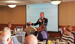 "Chief Warrant Officer-3 Jeff Price, former commander of 1st Infantry Division Band, speaks to attendees on the importance and history of the Army band as the guest speaker for the Feb. 25 Junction City Military Affairs breakfast at Riley's Conference Center. ""Army music has always been a part of the Army,"" Price said. ""It's not just because it moves troops on the battlefield, it's because it's part of who we are."""