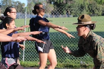 Drill Instructor Staff Sgt. Kayla Cerda commands poolees pf Recruiting Stations Los Angeles and Orange County to run in the place during a female pool function at the Sherman Oaks Recreation Park in Van Nuys, Calif., March 12, 2016. (U.S. Marine Corps photo by Staff Sgt. Alicia R. Leaders/Released)