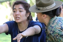Drill Instructor Staff Sgt. Kayla Cerda commands Celeste Ybarra from Recruiting Sub Station Eagle Rock of Recruiting Station Los Angeles, to run in place during a female pool function at the Sherman Oaks Recreation Park in Van Nuys, Calif., March 12, 2016. (U.S. Marine Corps photo by Staff Sgt. Alicia R. Leaders/Released)