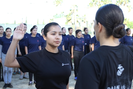 Staff Sgt. Maria E. GarciaRazo re-enlists in the Marine Corps for four more years during a Recruiting Station Los Angeles female pool function at the Sherman Oaks Recreation Park in Van Nuys, Calif., March 12, 2016. GarciaRazo is currently the staff noncommissioned officer of Recruiting Sub Station Hollywood of Recruiting Station Los Angeles. (U.S. Marine Corps photo by Staff Sgt. Alicia R. Leaders/Released)