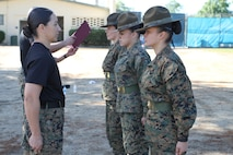 Recruiting Station Los Angeles Commanding Officer Maj. Aixa Dones, left, recognizes Staff Sgts. Adrianna Medina, Kayla Cerda, and Karin Guajardo, for their participation in the female pool function at the Sherman Oaks Recreation Park in Van Nuys, Calif., March 12, 2016. The drill instructors met with poolees face-to-face to help prepare them for Marine Corps boot camp. (U.S. Marine Corps photo by Staff Sgt. Alicia R. Leaders/Released)