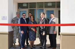 EL PASO, Texas -- Deputy District Commander Maj. Jason Melchior (left) participated in a ribbon-cutting ceremony with officials from Immigration and Customs Enforcement (ICE), Fort Bliss and the contractor to officially open a new 80,000 square-foot facility for ICE on Fort Bliss property here, Feb. 24, 2016. ICE Director Sarah Saldaña (center) prepares to cut the ribbon.