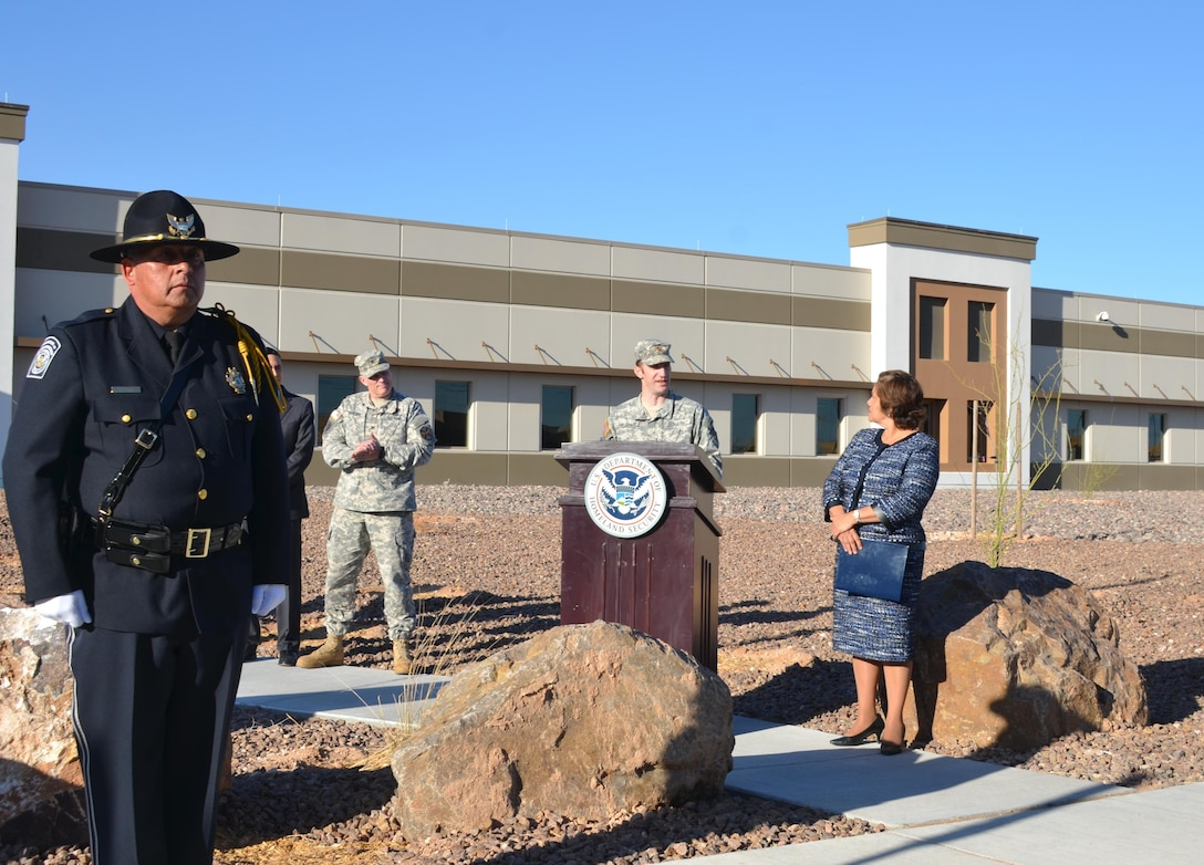 EL PASO, Texas -- ICE Director Sarah Saldaña (right) listens as Deputy District Commander Maj. Jason Melchior speaks during the ribbon-cutting ceremony officially opening the new Immigration and Customs Enforcement facility, Feb. 24, 2016.