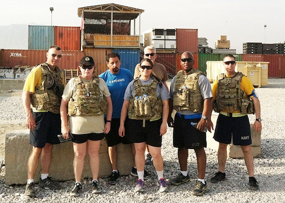Defense Logistics Agency Aviation Director of Business Process Support, Teresa Smith, first row, second from the left, stands with team members as they prepare for a 10-mile Ruck March on July 28, 2015 at Bagram Airfield, Afghanistan. Smith used the physical resiliency building block to help cope with the stress when she deployed in 2015 as the DLA Support Team Afghanistan deputy commander.