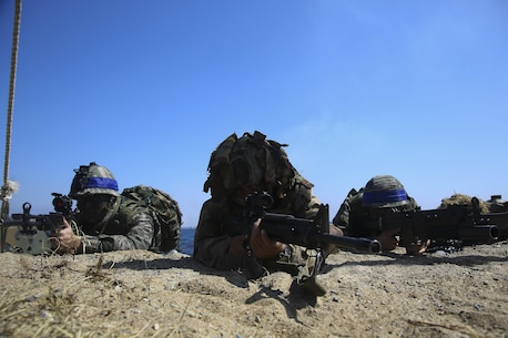 A New Zealand Soldier and Republic of Korea  Marines rehearse an amphibious assault, on Doksukri Beach, Republic of Korea, March 11, 2016, for exercise Ssang Yong 16. Ssang Yong is a biennial military exercise focused on strengthening the amphibious landing capabilities of the ROK, the U.S., New Zealand and Australia. (U.S. Marine Corps photo by Cpl. Allison Lotz/Released)