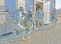 Soldiers with 1st Battalion, 16th Infantry Regiment, 1st Armored Brigade Combat Team, 1st Infantry Division, conduct room-clearing training during infantry gunnery training Feb. 19 at the Digital Multi-Purpose Range Complex, Fort Riley, Kansas. Dismounted, on-foot operations were the final part of day-training on the course. Prior to conducting the room-clearing training, the Soldiers practiced utilizing their Bradley Fighting Vehicles in order to strengthen the unit's lethality in multiple combat scenarios.