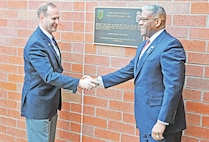 Retired Col. Ralph Kauzlarich, left, honorary commander of 1st Battalion, 16th Infantry, 1st Armored Brigade Combat Team, 1st Infantry Division, shakes hands with former congressman Allen West, an honorary member of the 16th Inf. Regt, after they unveiled the unit's First Gulf War plaque during a ceremony Feb. 25.
