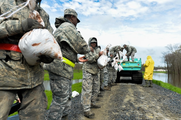 Barksdale Airmen unload sandbags from a city vehicle in Bossier City; La.; March 10; 2016. Airmen created a protective barrier over The Red Chute Bayou levee in an attempt to slow down corrosion caused from excess waters flowing down from the ArkLaTex region. (U.S. Air Force photo/Senior Airman Mozer O. Da Cunha)