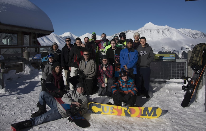 Airmen from Eielson Air Force Base, Alaska, pose at the top of Alyeska Ski Resort March 3, 2016, Girdwood, Alaska. The group visited the resort as part of a chapel-sponsored event. (U.S. Air Force photo by Senior Airman Joshua Weaver/Released)