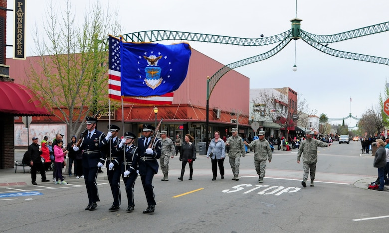 Beale Air Force Base Honor Guard and 9th Reconnaissance Wing leadership walk in the 136th Bok Kai Festival Parade in Marysville, California, Mar. 12, 2016. Beale has participated in the parade for more than 20 years. The festival celebrates the Chinese Water God of the North.